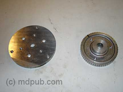 The pully and a disk drilled and tapped