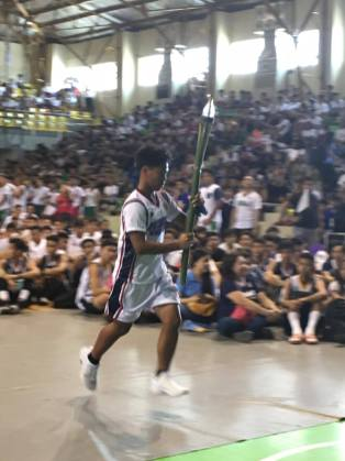 Sagradan Palaro gold medalist, Mico Angelo Del Poso carrying the torch during the BulPriSA opening
