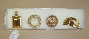 41.  Four Gold Jewelry Items ( Scarf Holder, Two Pins, A Slider)