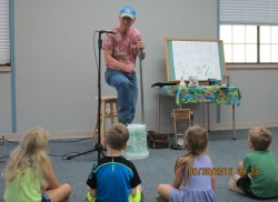 "Thad Beach entertains the kids with his ""Shake, Rattle and Roll"" musical program."