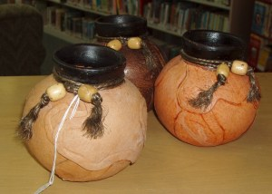 60 - 61.  Three Indian Bowls, Terra Cotta with Dried Leather