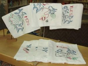 69.  Set of Seven Embroidered Tea Towels