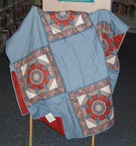 """73. Blue and Rust Reversible Quilt 80""""x48"""""""