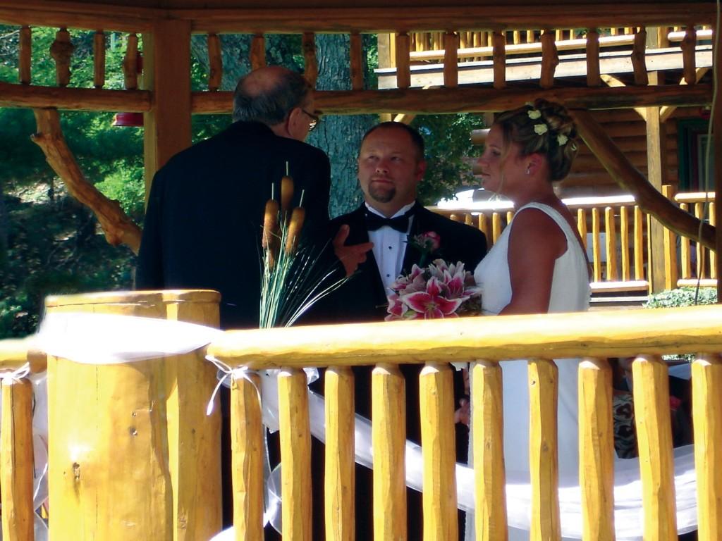 Outdoor Wedding in Gazebo at Meadowbrook Resort & DellsPackages.com in Wisconsin Dells