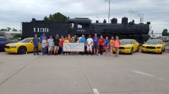 On Sunday, a donation was given to the Meadowlark House from a group of Dodge Charger Daytona owners who met in Dodge City.