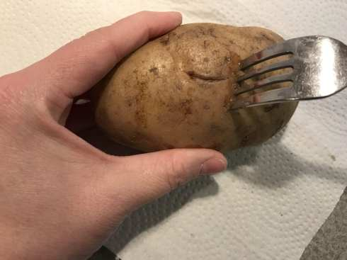 Pierce the potato with a fork before microwaving.