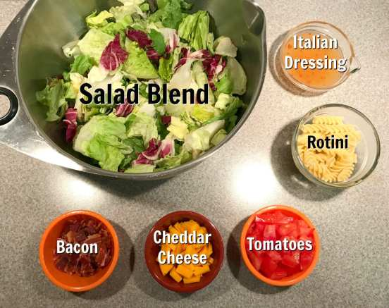 Ingredients for Italian Chopped Salad: Romaine, Bacon, Rotini, Cheese, Tomatoes and Italian dressing
