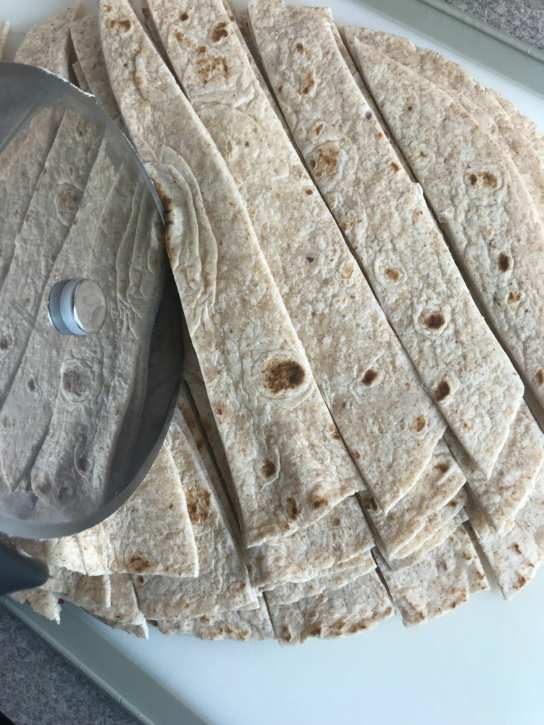 Use a pizza cutter to make cutting flour tortillas a cinch