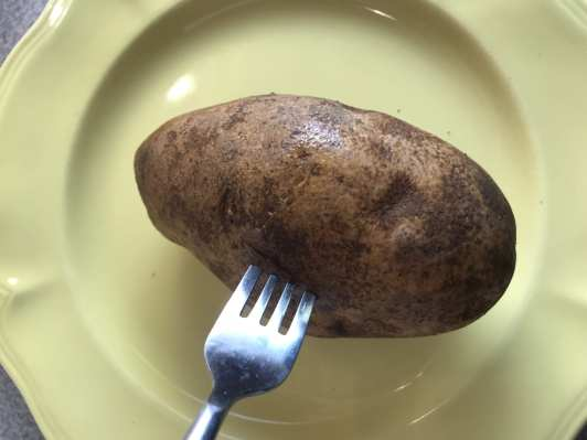 Pierce the potatoes with a fork so the steam can escape as it cooks.