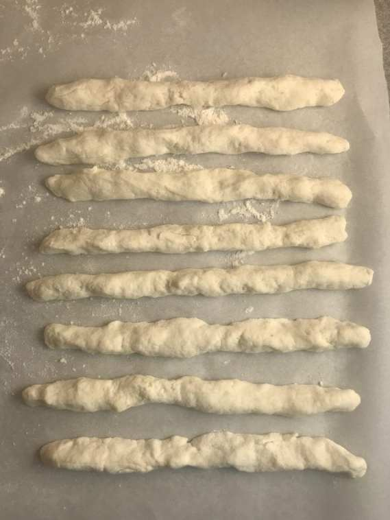 Roll the dough into long snake-like pieces.