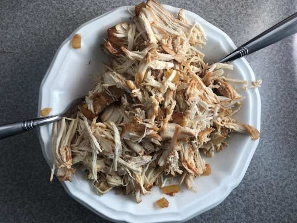 Shred the chicken from the slow cooker using 2 forks.