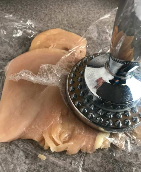 Pound down chicken with tenderizer.