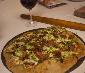 Pizza with zucchini, bacon and mozzarella