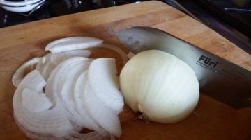 I cut the onion in half and lay the flat side on the cutting board...easier to slice