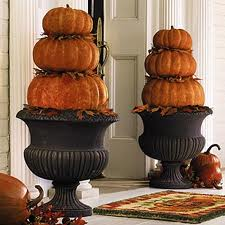 Place 3 different sizes of pumpkins near your front door.  If you have urns...use them!