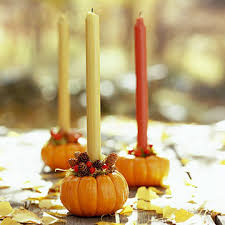 How about this simple trick?  Hollow out little pumpkins, add berry picks or leaves or both and various colored tapers