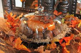I like using my cake plate and cover to decorate my sideboard. Put gourds, acorns, small pumpkins under the dome, and decorate the base with Spanish moss and leaves