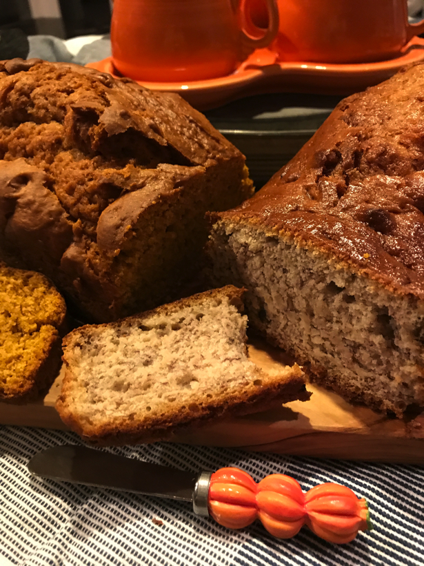 Homemade soup and banana nut bread sitting on countertop.