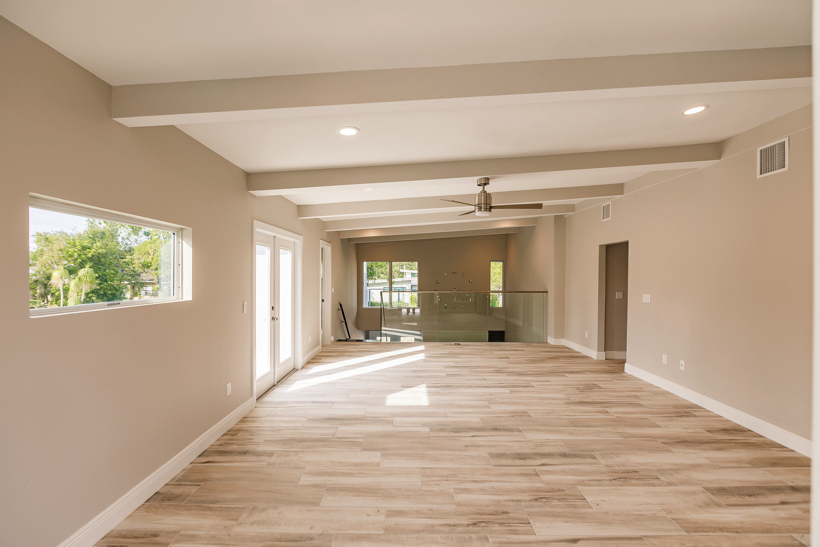 But this family room is huge and because of that we added cabinetry, a sink, a fridge and wine cabinet.