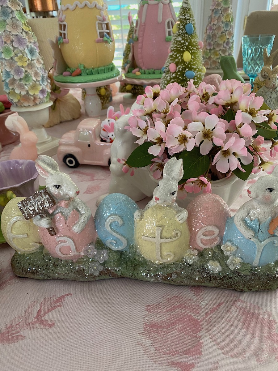 Easter bunnies spelling out Easter using pastel pink and blue.