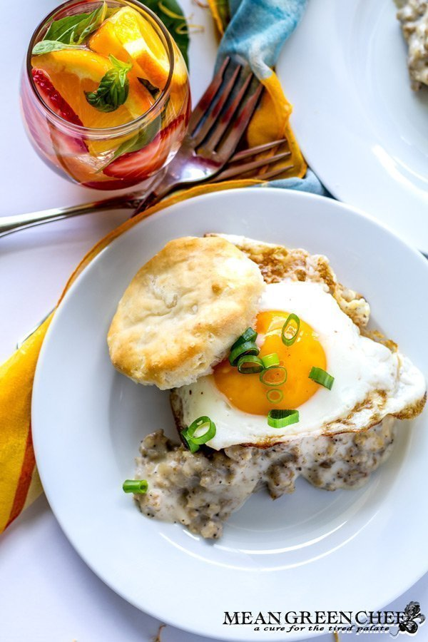 Easy Country Sausage Gravy, served over fluffy buttermilk biscuits and topped with a bright sunny side up egg, a fast indulgent breakfast ready in 20 minutes flat! Mean Green Chef #sausagegravy #breakfast #breakfastrecipes #sausagegravy #sausage #biscuitsandgravy #foodphotography #foodstyling #meangreenchef #MGCKitchens