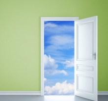 Open door with view of clouds