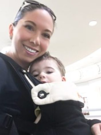 mom and baby in baby carrier at airport
