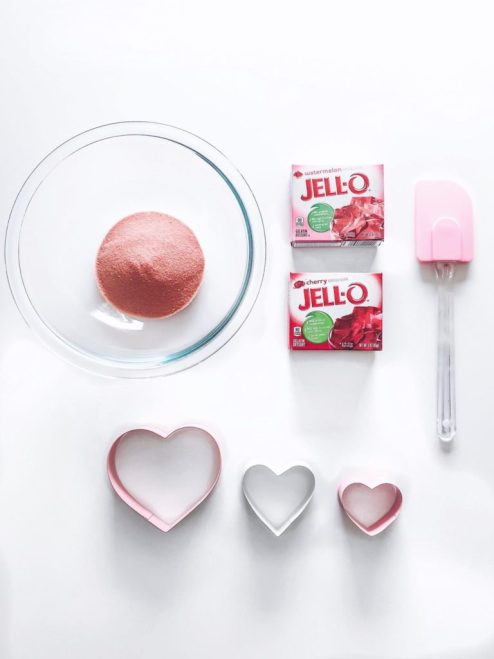 jello boxes pink spatula jello powder in a glass bowl heart shaped cookie cutters