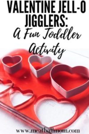 Looking For a Fun Toddler Activity for Valentine's Day? These Jell-O Jigglers are sure to be a hit! #valentinesday #valentinetreat #valentinedessert #toddleractivity #valentine #valentinedessertideas #valentineidea #toddlers #dessert #dessertideas #jello