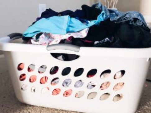 tips for cleaner home; laundry basket full of clean clothes