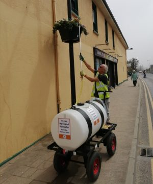 BTT Volunteer, Tony Lennon, using our mobile watering unit to water the planters with harvested rain water.