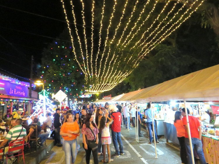 Christmas lights in Sabaneta with booths selling food and drinks
