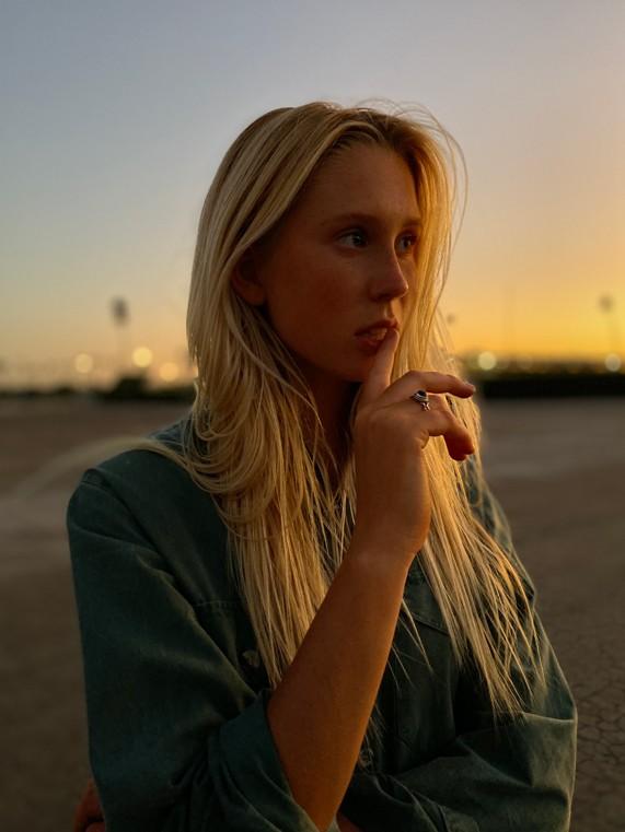 Apple_iPhone-11-Pro_Portrait-Woman-Sunset_091019_carousel.jpg.large