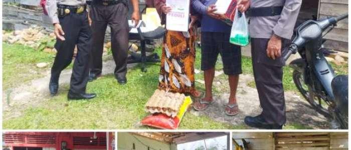 Kapolsek Kampar Kiri Kunjungi Korban Angin Puting Beliung dan Berikan Bantuan Sembako Kepada Warga Desa Gema