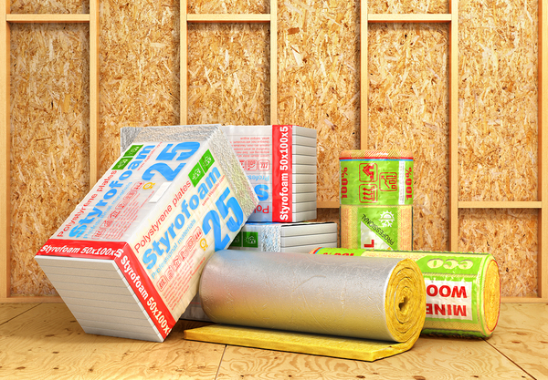 Bare walls with different types of insulation packaged up.