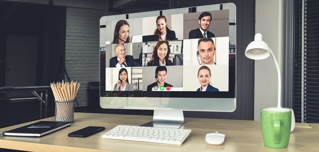Video conference displayed on a computer monitor.
