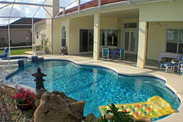 Pool covered with a screened covering.