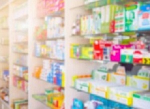 Medicines on pharmacy store shelves blurred background