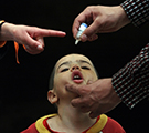 An Afghan health worker administers the polio vaccine to a child during a vaccination campaign in 2010 in Kabul, Afghanistan
