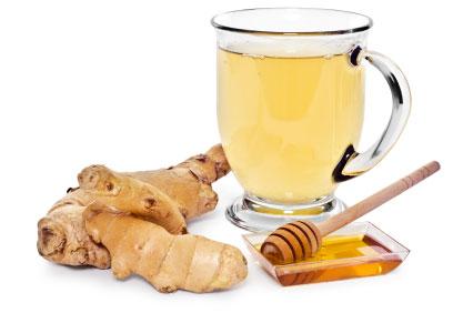 A glass mug of ginger tea