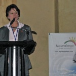 Maria K Todd, MHA PhD at podium 1st medical tourism Congress in South Africa