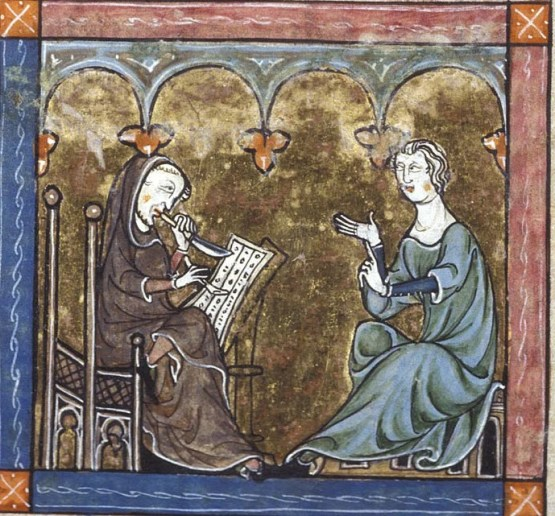 Miniature of Gawain in a green robe seated before master Blaise, who is holding a knife and quill, writing down his adventures as he is telling them. Photo courtesy British Library