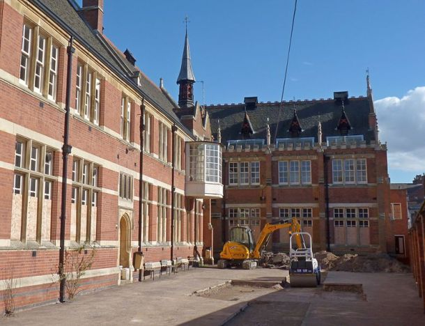Alderman Newton's Boys School. The furthest section is the original school, with extensions along the left side. Trench 3 of the 2012 dig can be seen in the former playground
