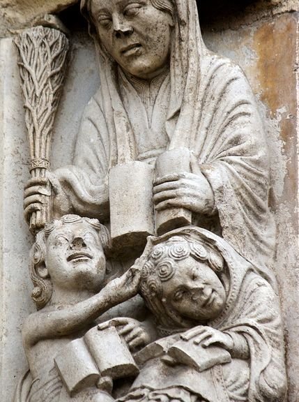 The figure of Grammatica, the first stage of medieval education, threatens an inattentive student with her birch - south portal, Chartres cathedral, c.1150. Photo courtesy University of Leicester