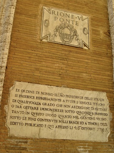 Rione plaque on a wall in Rome.