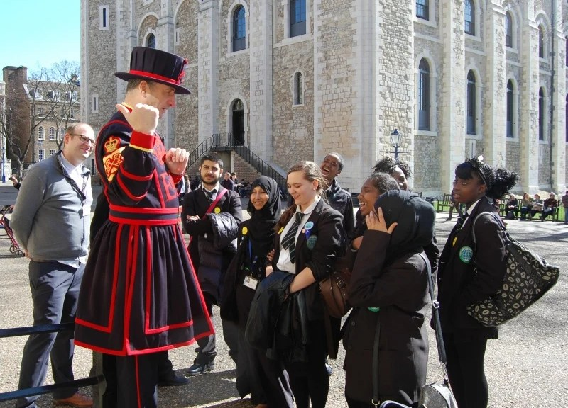 Yeoman Warder speaking to a group of school children at the Tower of London. Photo courtesy of Represent London, lotterygoodcauses.org.uk.