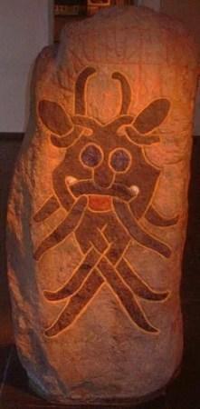 Århus Mask rock engraving rune stone (DR66),  Århus, Denmark. 10th cent., Image courtesy of CC-BY-SA-2.5; photographer Lars Zwemmer.