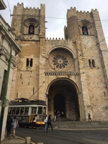 Lisbon Cathedral with the famous Tram 28 car going past. Photo by Medievalists.net
