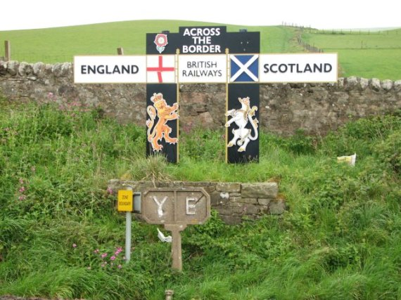 England / Scotland border British Railways sign board by the east coast mainline, marking the border.  Photo by Callum Black / Wikimedia Commons
