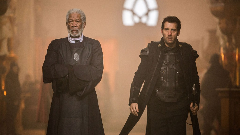 """Morgan Freeman as Lord Bartok, and Clive Owen as his loyal retainer and knight, Commander Raiden in, """"Last Knights""""."""
